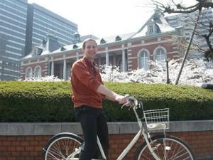 Riding the Muji e-bike through Tokyo during cherry blossom season