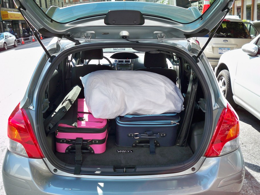 Fully Loaded Yaris In Brooklyn Takes Two Big Suitcases And