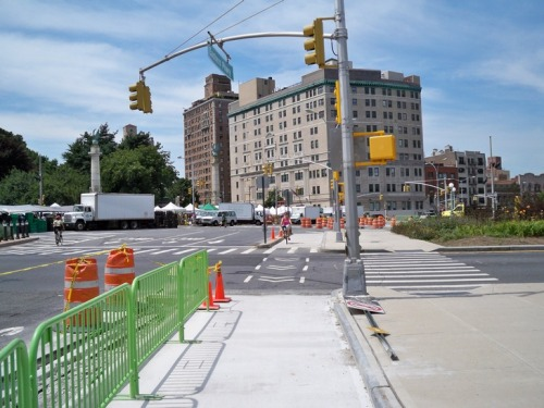 Protected cycle track under construction at the busy Grand Army Plaza traffic circle in Brooklyn, New York (photo by Aaron Dalton)