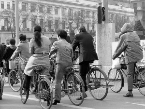 Here are some Chinese bicyclists who have stopped at a red light. See - it's not that hard to do! (photo by Matthew Stinson/Flickr)